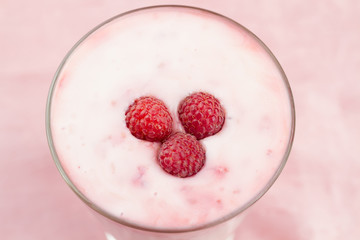 Raspberry smoothie with berries on wooden background. Healthy vegetarian food, diet.