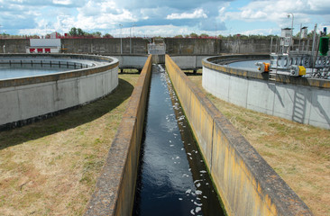 Channel with water from wastewater treatment plant