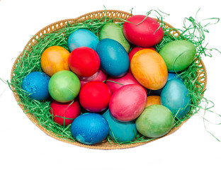 Colored easter eggs placed in a basket