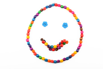 Smile of colorful wooden beads isolated on white