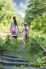 Two girls go by railway