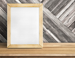 Blank whiteboard wood frame on wooden table at diagonal wood wal
