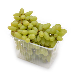 White grapes in the package isolated on white.