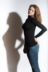 Potrrait of young beautiful woman with shadow