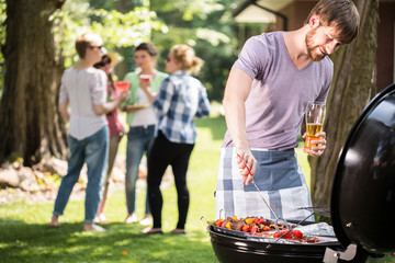 Young man doing barbecue