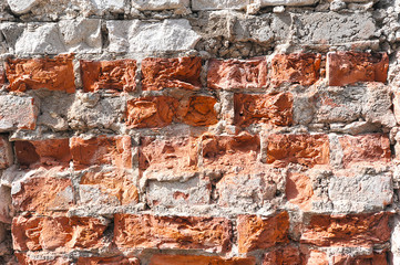 abstract background from a damaged brick and masonry