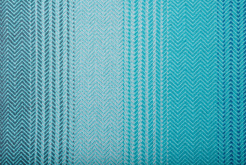 Handmade fabric with green and blue striped texture. Clothes background