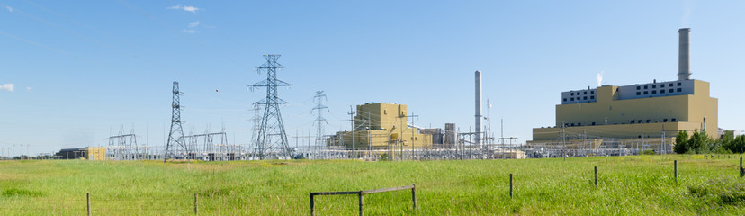 Coal burning power station in green landscape