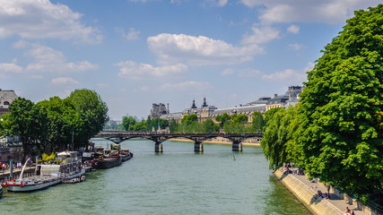 Pont des Arts or Passerelle des Arts, a pedestrian bridge in Paris which crosses the Seine River. It links the Institut de France and the central square of the Louvre Palace