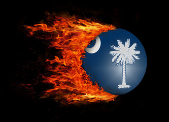 US state flag with a trail of fire - South Carolina
