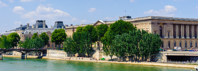 Art bridge and the Louvre Palace in Paris, France