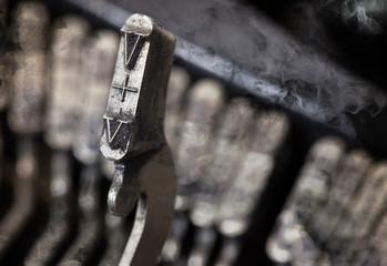 V hammer - old manual typewriter - mystery smoke