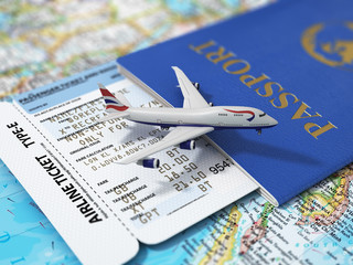 Travel concept. Passports, airline tickets and airplane on the w