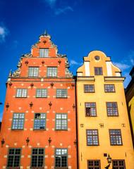 Red and Yellow iconic buildings on Stortorget,  a small public square in Gamla Stan, the old town in central Stockholm, Sweden.