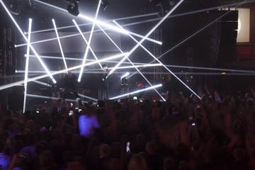Light striking a rock concert