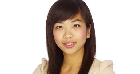 Cute Chinese woman looking at camera