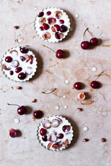 three cherries clafoutis from above on marble surface