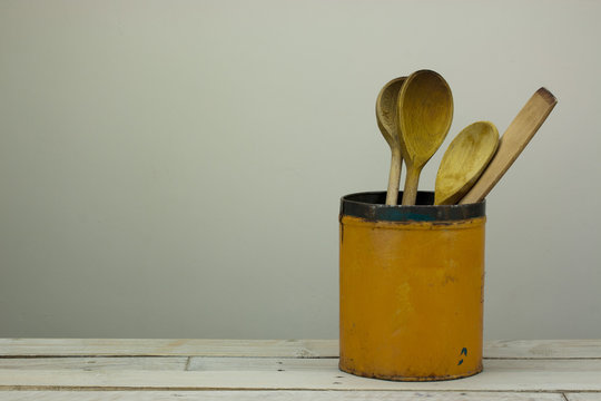 Wooden spoons in a tin