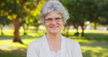 Senior woman smiling at the park