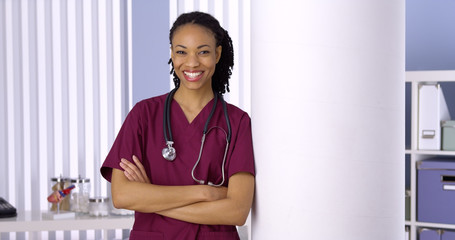 Confident black woman doctor smiling in office