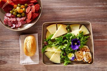 Spain food tapas ham sausage and cheese salad