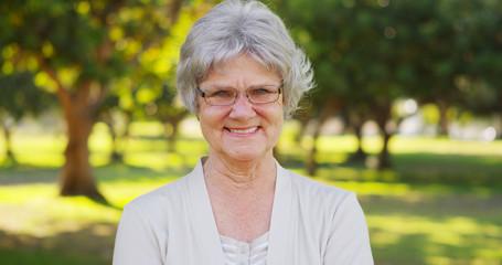 Senior woman laughing at the park