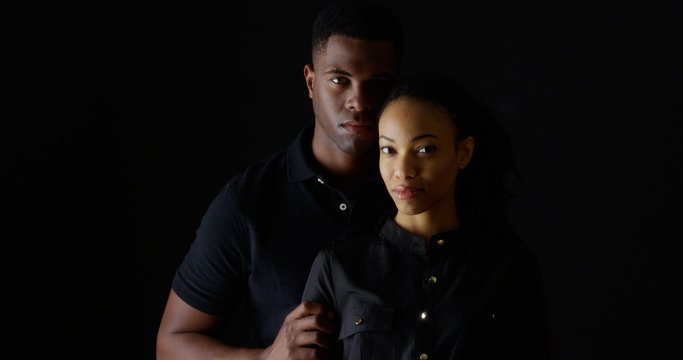 Dramatic portrait of strong young black couple