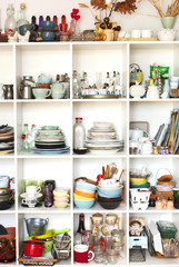 Food photography props. Ceramics and kitchen equipment on shelve