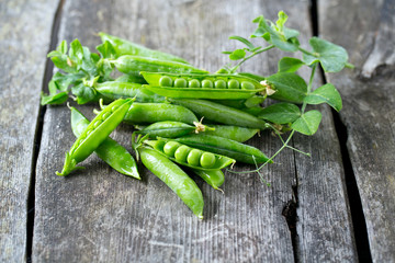 pea pods on wooden table