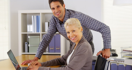 Successful businessteam smiling at camera