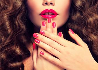 Beautiful girl showing crimson  manicure