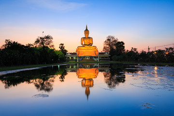 Big Buddha statue on sunset sky with reflection,Thailand