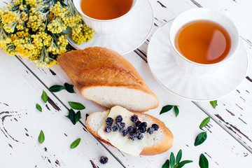Diet breakfast with Herbal tea and bread with butter and blueberries
