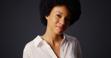 Portrait of black woman with afro and white blouse