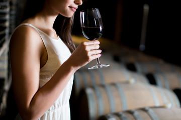 Fototapeta Young woman in the wine cellar