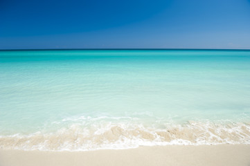 Acrylic Prints Caribbean Shore of classic turquoise Caribbean Sea dream beach under bright blue sky in Varadero, Cuba
