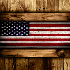 Abstract wooden background with a grunge USA flag.