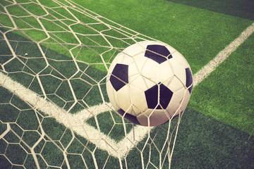 soccer ball in goal vintage color