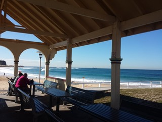 Nobbys Beach Pavillion with background surf, Newcastle Australia