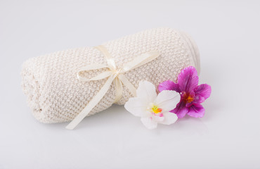Towel and aromatic candle