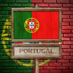 Portugal flag wooden sign with brickwall background