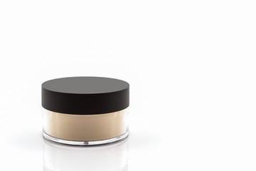Bottle of make up powder.