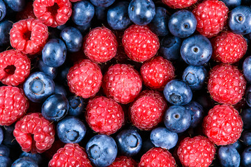 Clouse up Fresh Organic  Blueberries and Raspberries. Rich with vitamins Background, texture