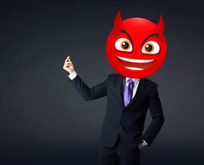 businessman wears devil smiley face