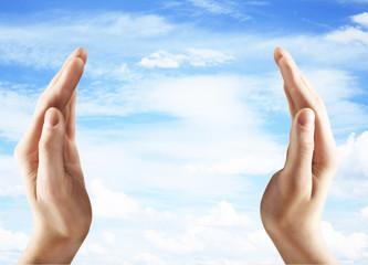 hands holding blue sky