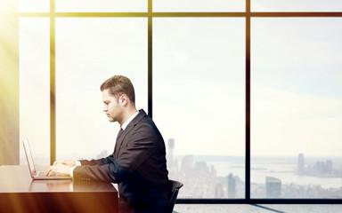 busienssman sitting in office