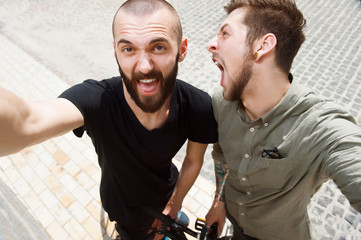 Attractive young men are picturing themselves in city