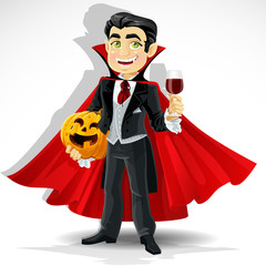 Charming predatory vampire with Halloween pumpkin