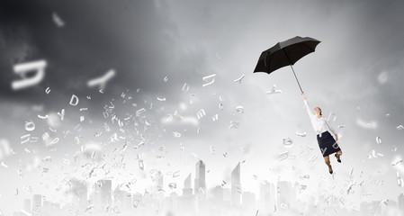 Woman fly on umbrella