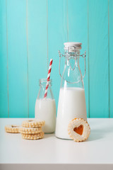 Old fashion milk jars with heart shaped cookies